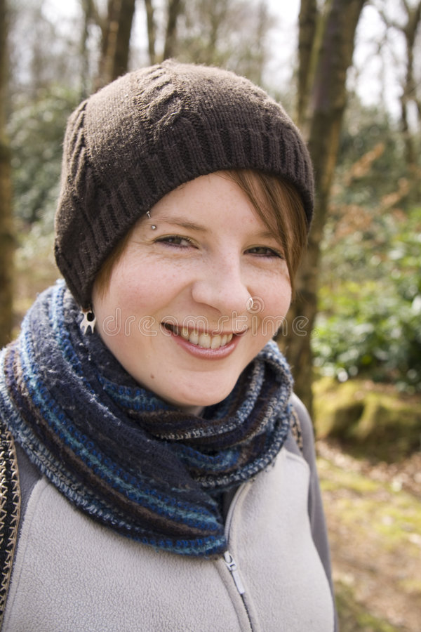 Download Happy Girl Wrapped Up In Hat And Scarfe Stock Photo - Image: 9215900