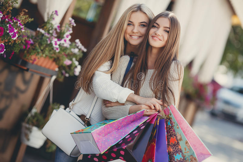 Download Happy Girlfriends Go Shopping At The Mall Stock Image
