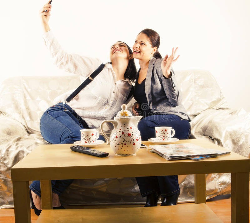 Happy girlfriends taking a selfie stock photos