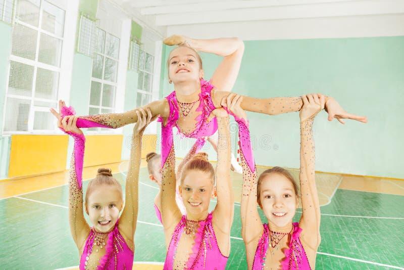 Happy girls doing routine in rhythmic gymnastics stock photo