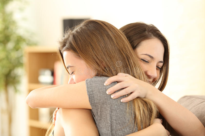 Happy girls embracing at home royalty free stock images