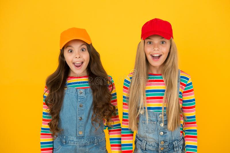 Happy girls. Friendly and happy children. Family look. Stylish children. Universal childrens day. Promote international. Togetherness awareness among children royalty free stock photo