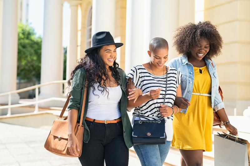 Happy girls friends walking outdoor royalty free stock photography