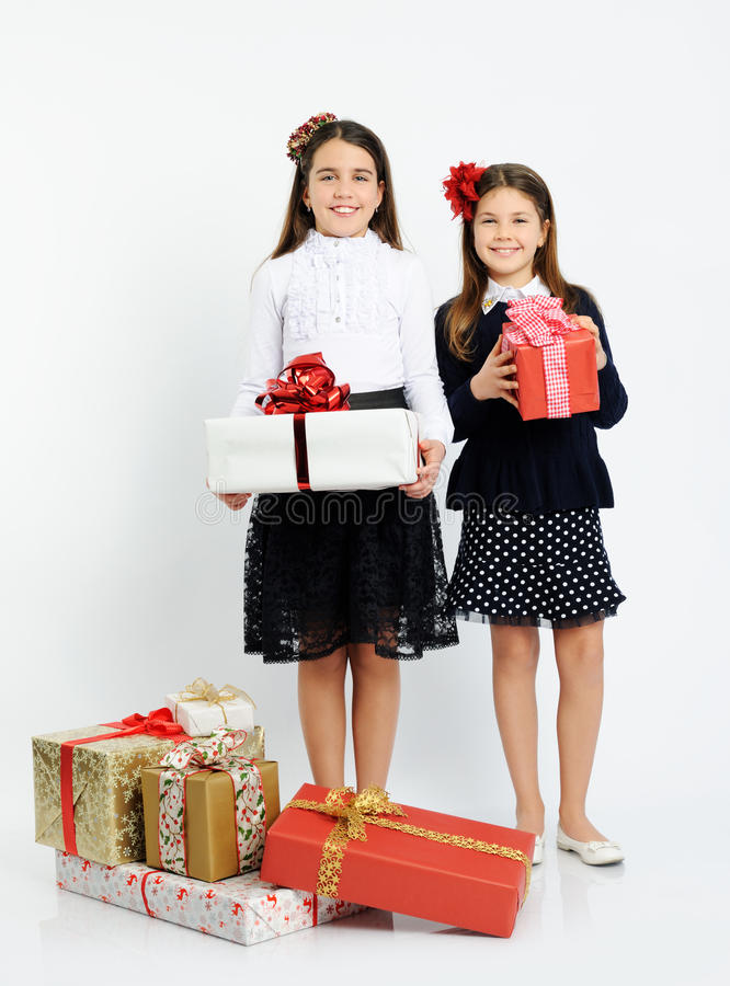 Happy girls with gifts. On light background stock image