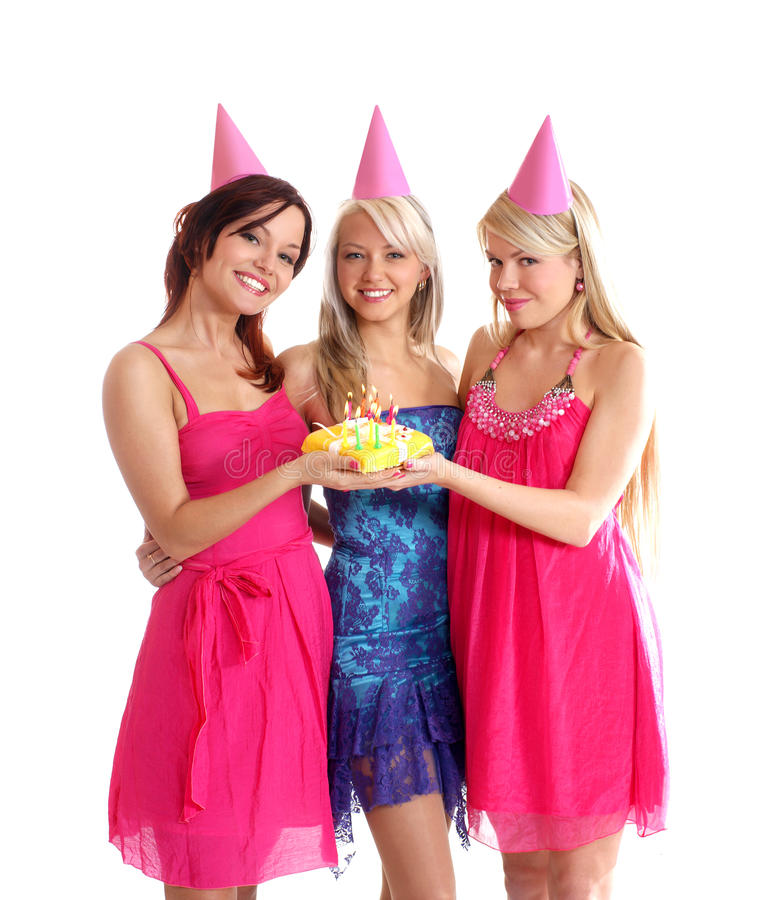 Happy girls having a Birthday party. Happy girls wearing pink party hats having a Birthday party with a cake. Image isolated on a white background stock images