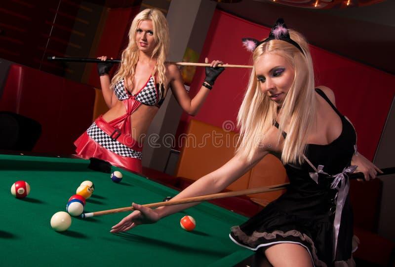 Happy girls playing in billiard stock photos