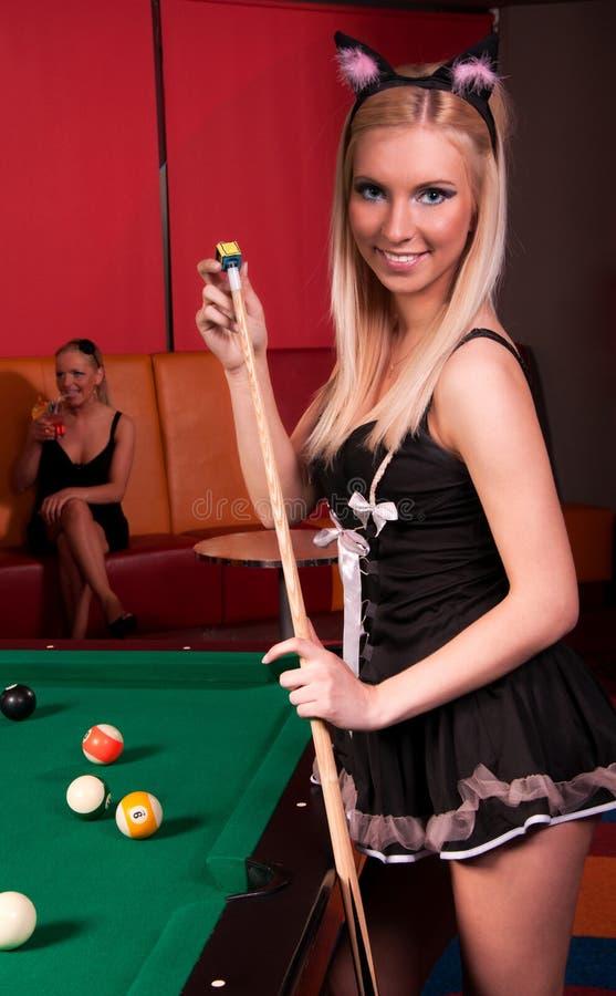 Happy girls playing in billiard stock image