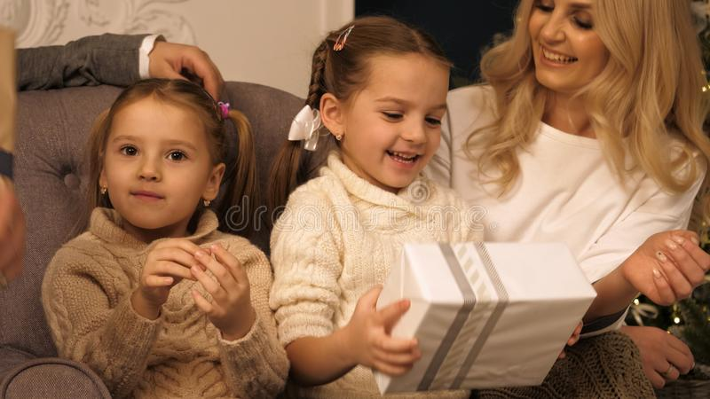 Happy girls shaking a present to guess whats inside. royalty free stock photography