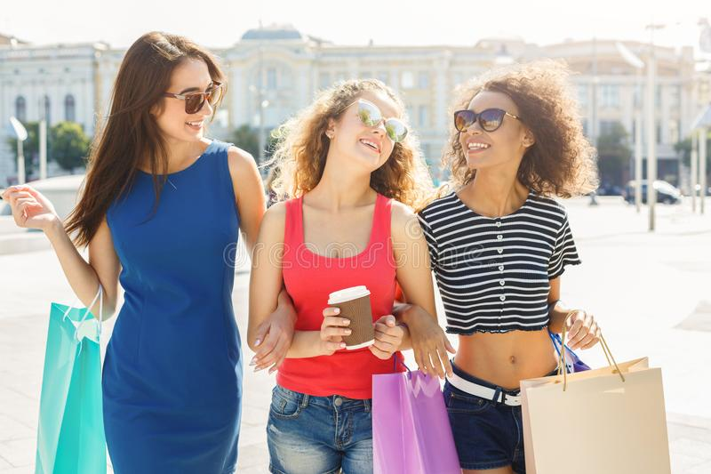 Happy female friends outdoors stock images