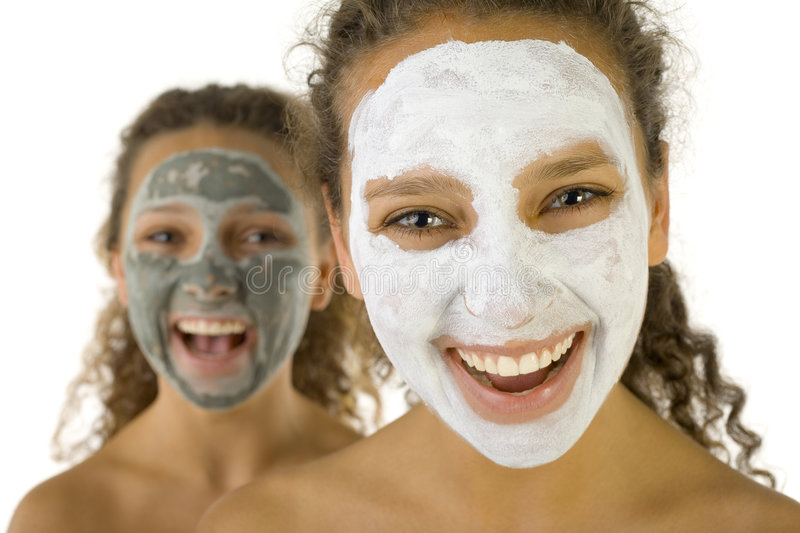 Happy girls with spa mask