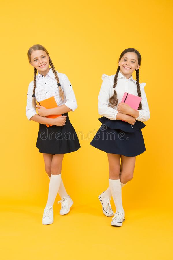 Happy girls study with workbook. literature lesson. childrens literature. reading and writing. small girls kids with. Book. back to school. Classmates at book royalty free stock photography