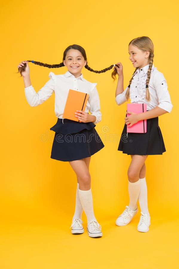 Happy girls study with workbook. reading and writing. small girls kids with book. literature lesson. childrens. Literature. back to school. Classmates at book royalty free stock images
