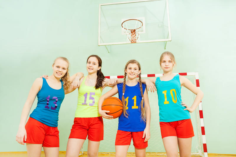 Happy girls after victory in basketball match stock photos