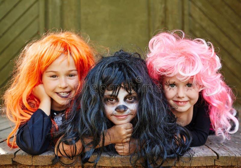Happy girls in wigs stock photos