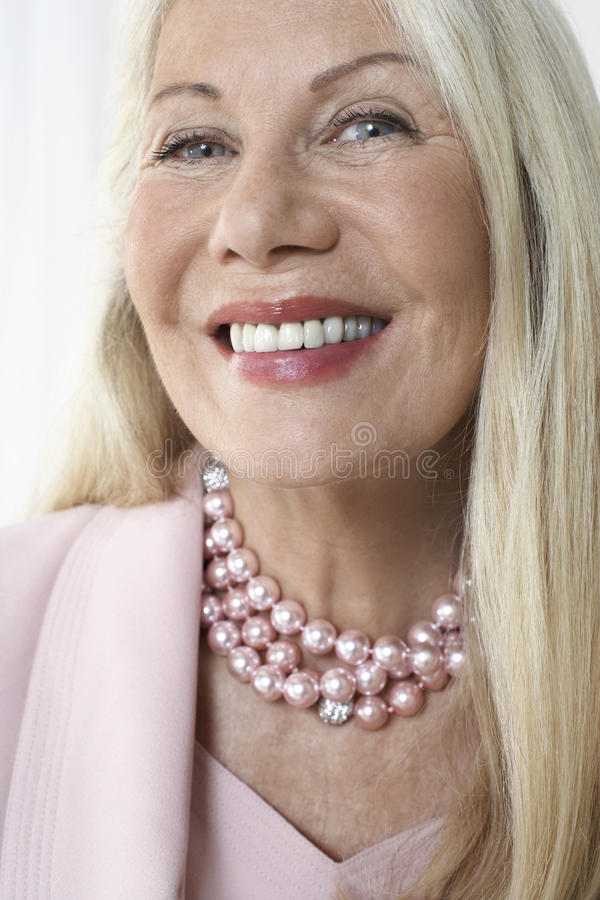 Happy And Glamorous Senior Woman Smiling royalty free stock images