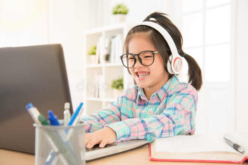 Happy glasses kids playing computer royalty free stock photography
