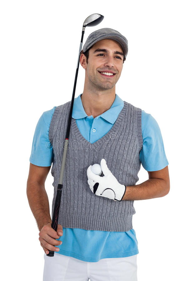 Happy golf player standing with golf ball and golf club stock photography