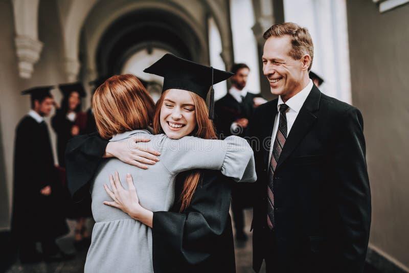 Happy. Good Mood. Parents. Student. Daughter. stock photos
