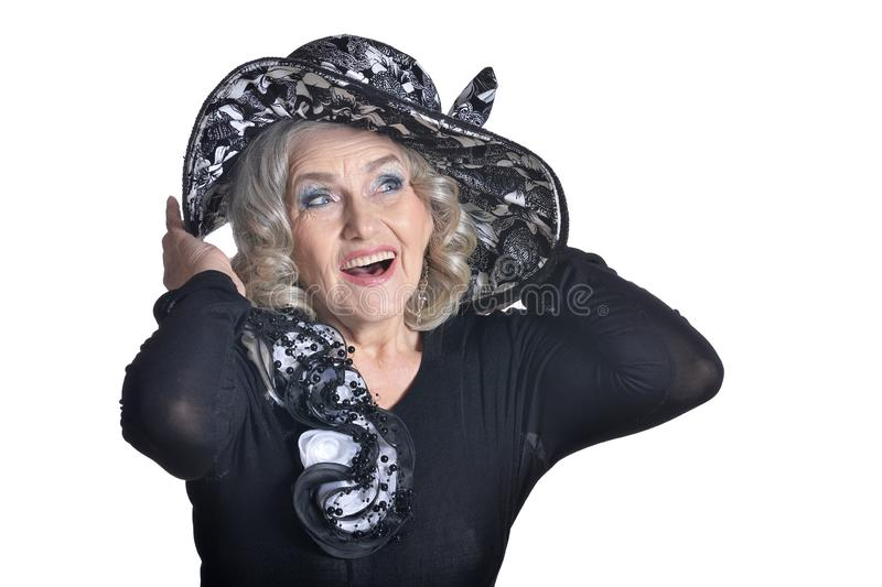 Happy gorgeous mature woman in hat posing isolated on white background stock images