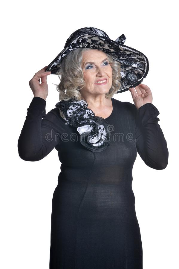 Happy gorgeous mature woman in hat posing isolated on white background royalty free stock photography