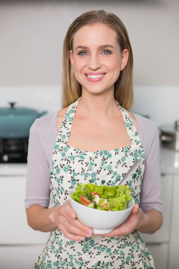 Happy gorgeous model holding salad bowl royalty free stock photo