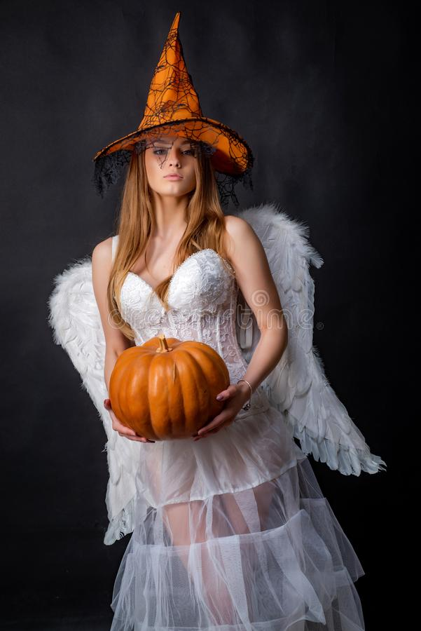Happy gothic young woman in angel Halloween costume. Angel Fashion Art design scene. Halloween girl in costume angel on royalty free stock photos