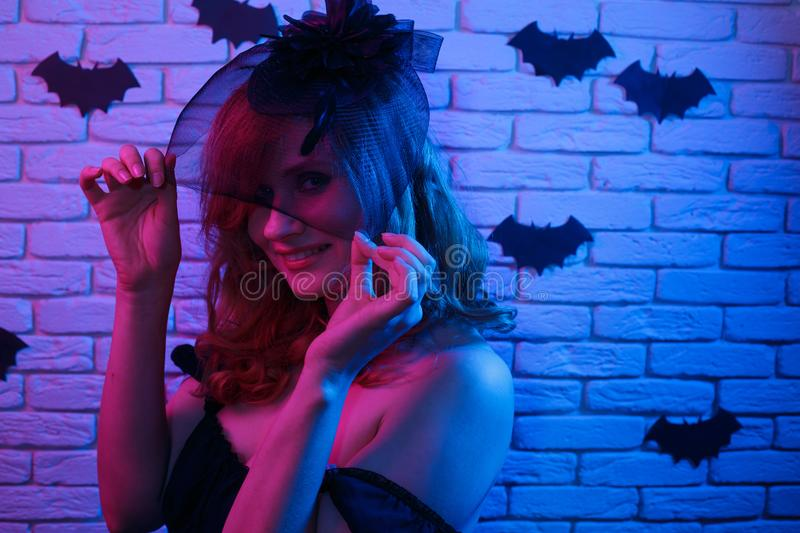 Happy gothic young woman in halloween costume partying in a nigh. Tclub. Halloween, celebration, party concept stock photo