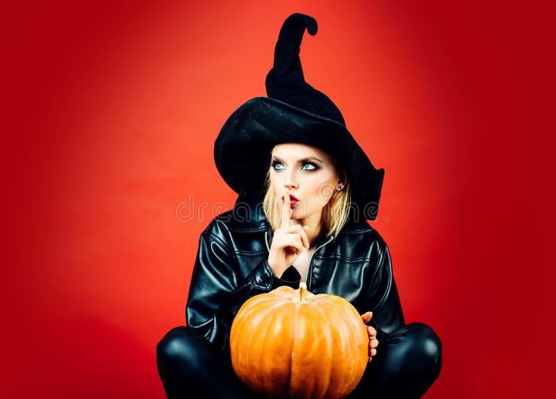 Happy gothic young woman in witch halloween costume. Secret Halloween. Happy gothic young woman in witch halloween cose. Secret Halloween royalty free stock photo