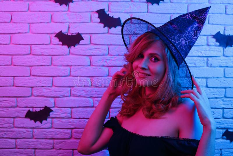 Happy gothic young woman in witch halloween costume partying in. A nightclub. Halloween, celebration, party concept stock images