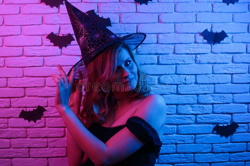 Happy gothic young woman in witch halloween costume partying in. A nightclub.Free space for text design. Halloween, celebration, party concept stock images