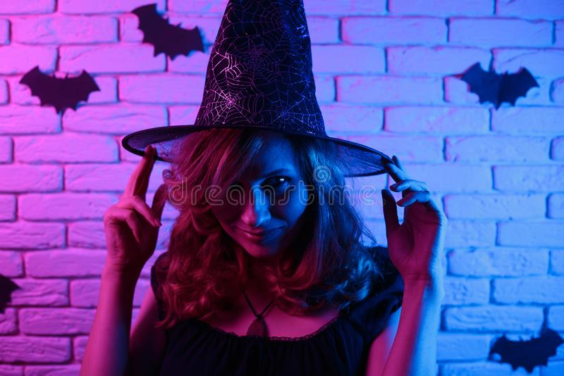 Happy gothic young woman in witch halloween costume partying in. A nightclub, image with free space for design. Halloween, celebration, party concept stock image