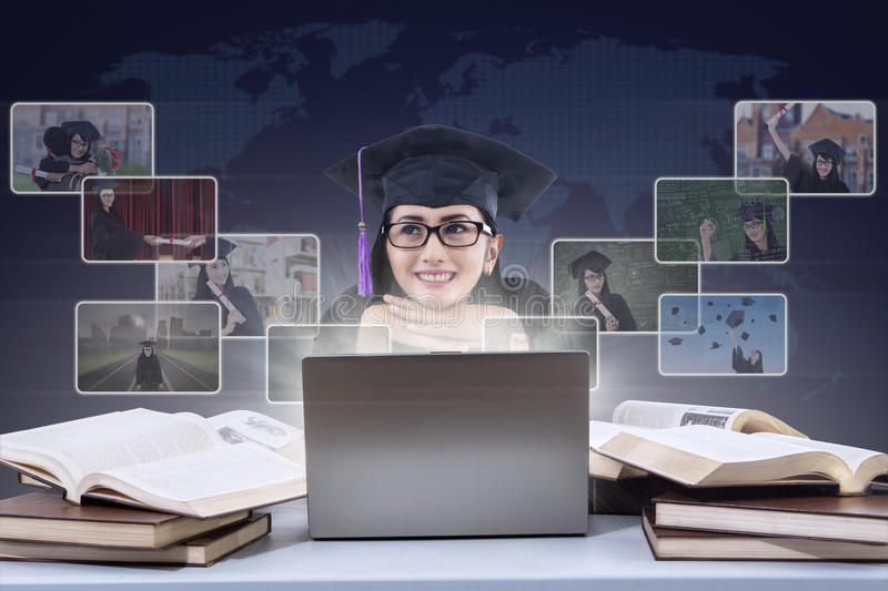 Happy graduate imagine online pictures on laptop royalty free illustration