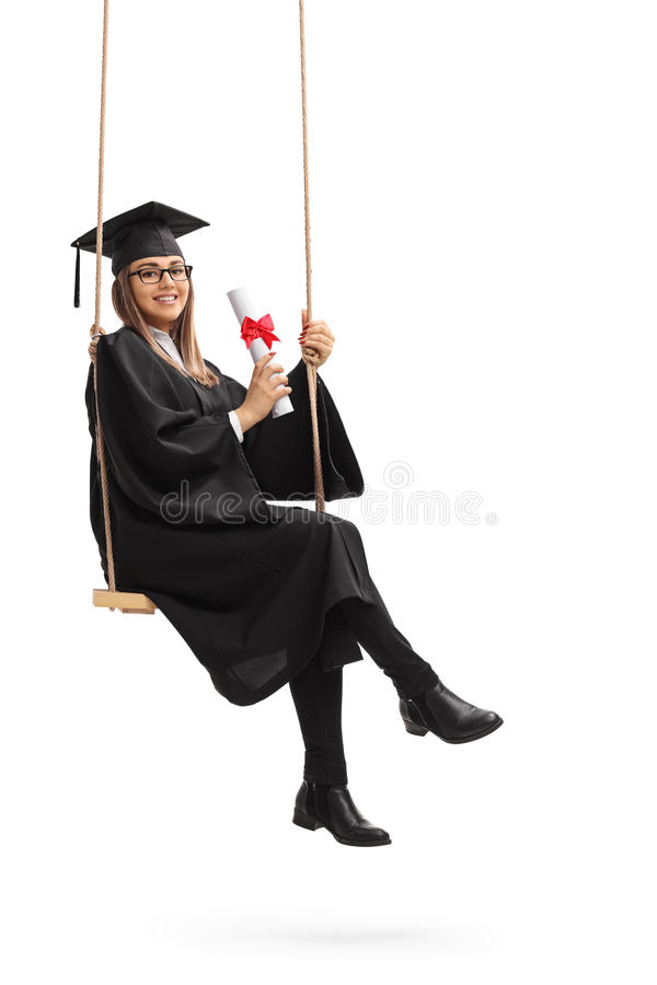 Happy graduate student with a diploma sitting on a swing stock photos