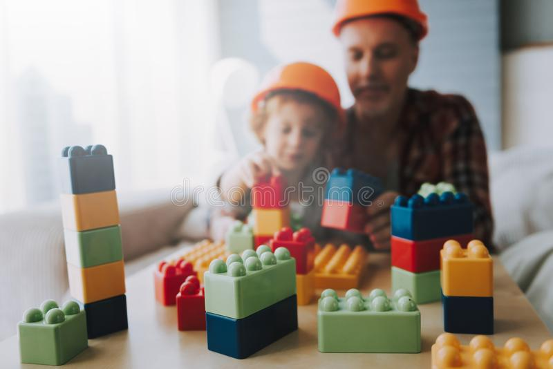 Happy grandfather and little grandson play blocks. Family fun. Leisure with grandson stock photos