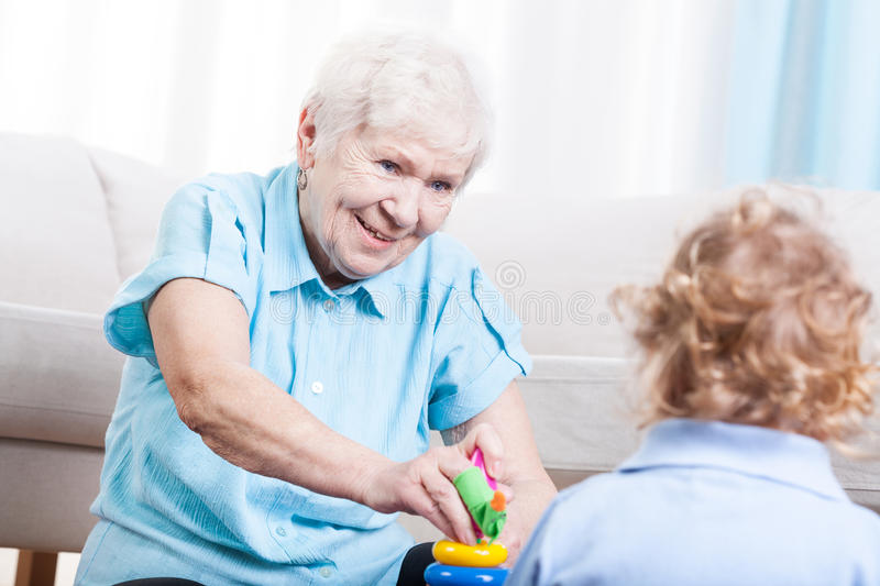 Happy grandmother with child. Happy grandmother having fun with little child stock photography