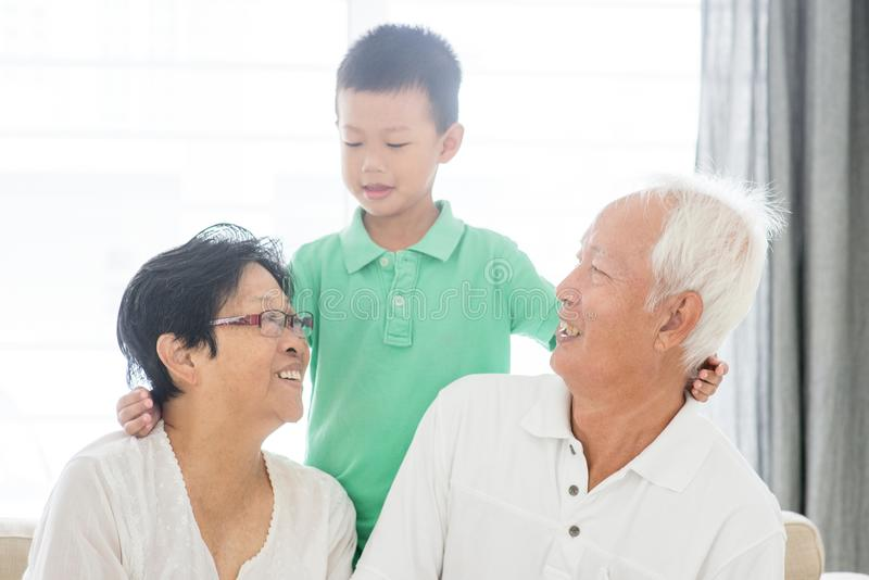 Happy grandparents and grandchild stock photos