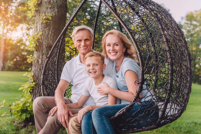 Happy grandparents and grandson stock photos