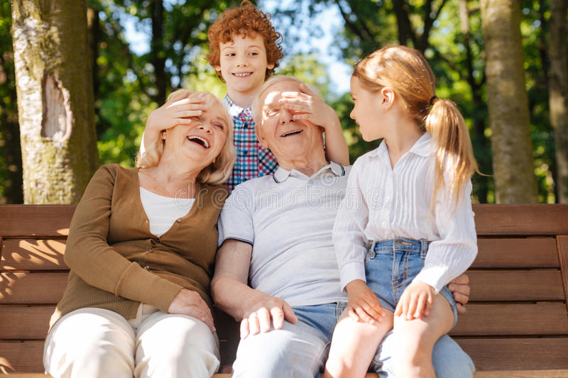 Happy grandparents spending time with children stock images