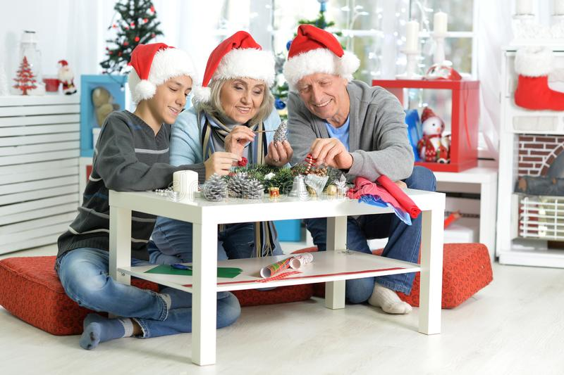 Portrait of grandparents with boy preparing for Christmas royalty free stock photography