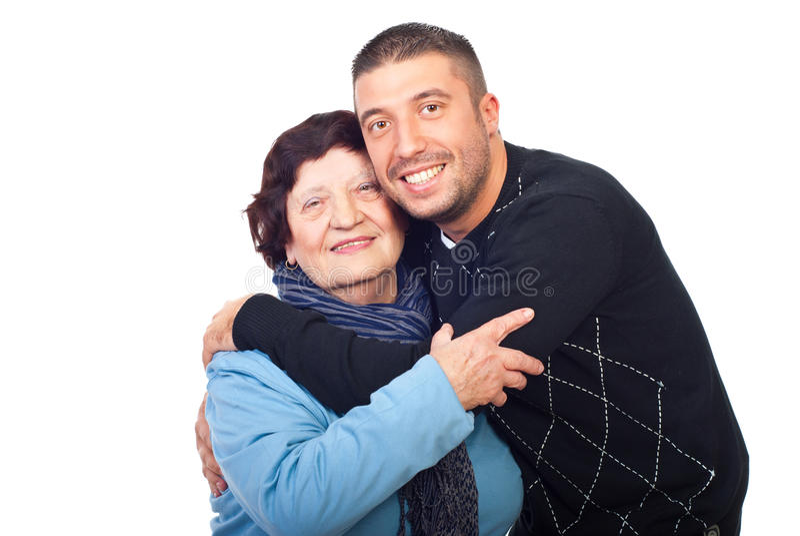 Happy grandson hugging grandma stock photography