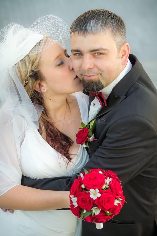 Happy groom and bride stock photo