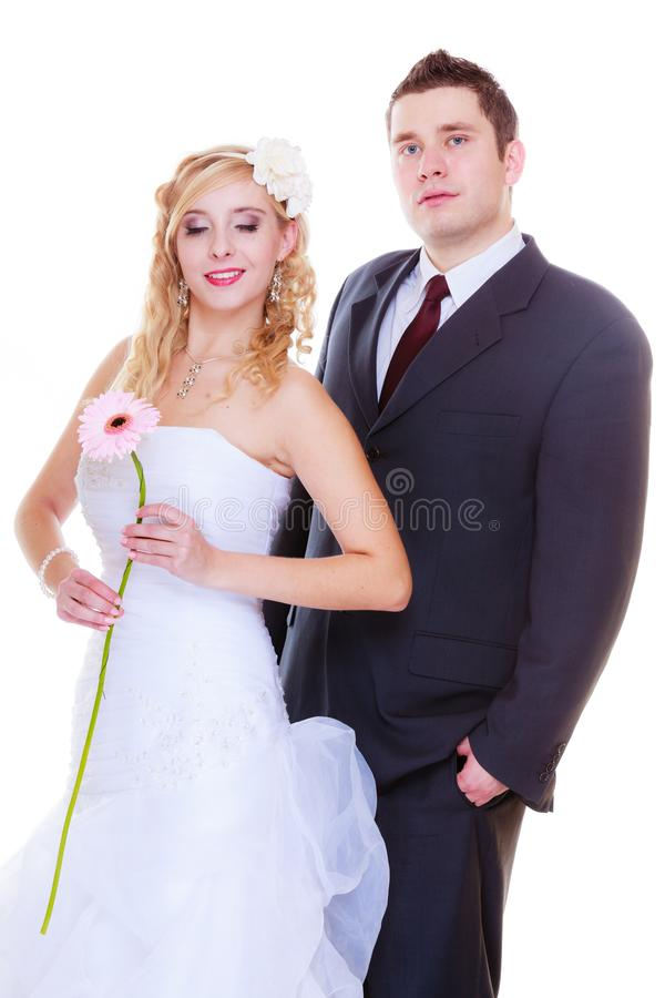 Happy groom and bride posing for marriage photo. Positive relationship couples concept. Happy groom and bride posing for marriage photo waiting for the big day royalty free stock photography