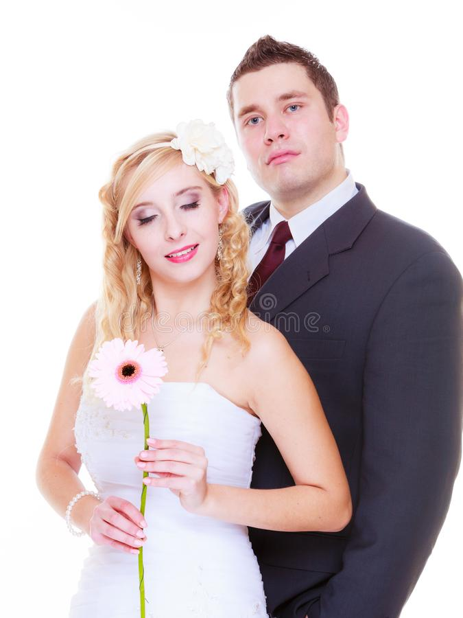 Happy groom and bride posing for marriage photo. Positive relationship couples concept. Happy groom and bride posing for marriage photo waiting for the big day stock image