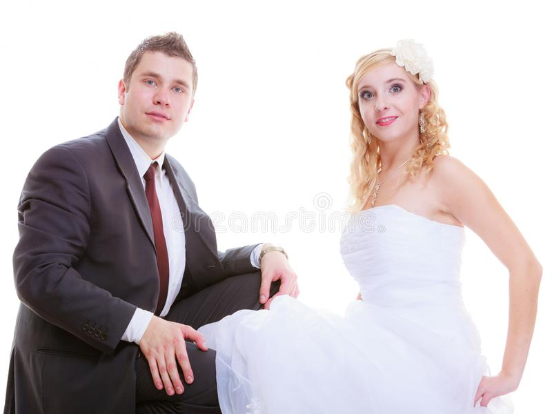 Happy groom and bride posing for marriage photo. Positive relationship couples concept. Happy groom and bride posing for marriage photo waiting for the big day royalty free stock photo