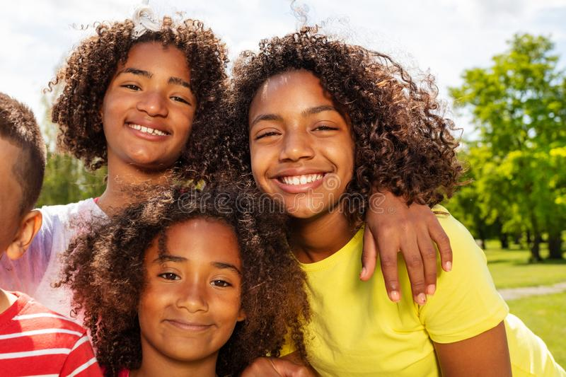 Happy group active portrait of cute kids in park stock image