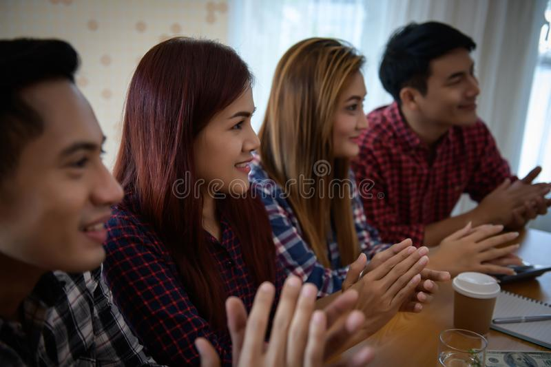Happy group of business people clapping in office meeting hands applauding at conference success stock photos