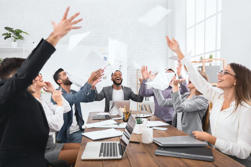 Happy group of business people throw documents royalty free stock photography