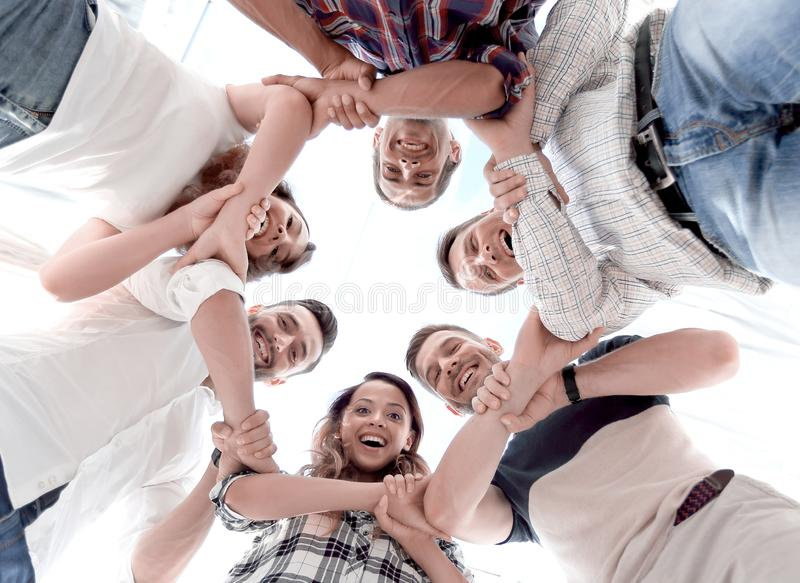 Happy group of businesspeople stacking their hands in cooperation royalty free stock photo