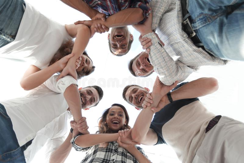 Happy group of businesspeople stacking their hands in cooperation royalty free stock photography