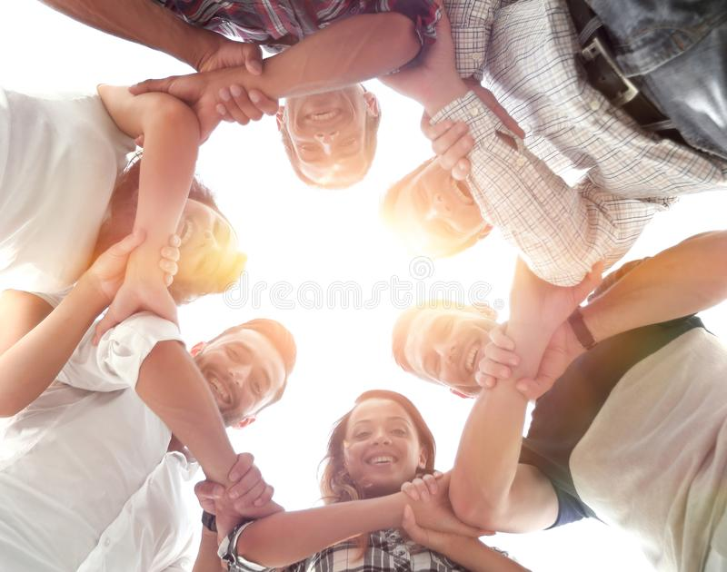Happy group of businesspeople stacking their hands in cooperation royalty free stock photos
